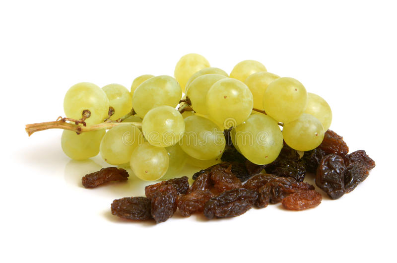 Bunch of grapes and raisins royalty free stock photos