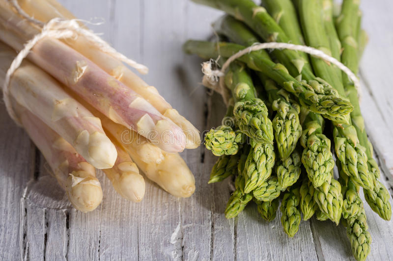 Bunch of green and white asparagus stock photos