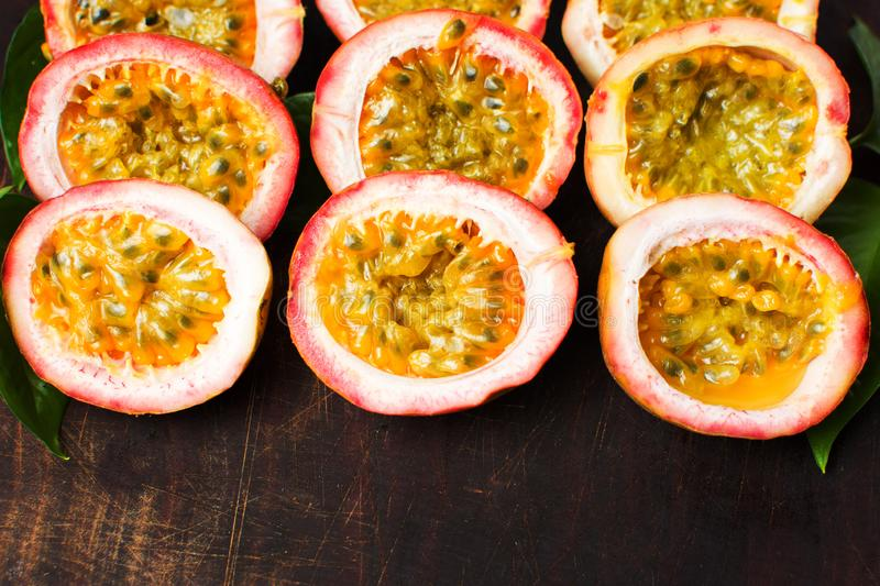 Bunch of halved passion fruit. Halved passion fruit on a wooden board royalty free stock photo
