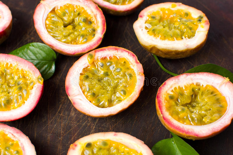 Bunch of halved passion fruit. On a wooden board stock photography
