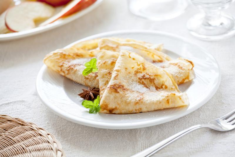 Homemade Crepes With Sugar. Bunch of homemade french crepes with sugar royalty free stock photo