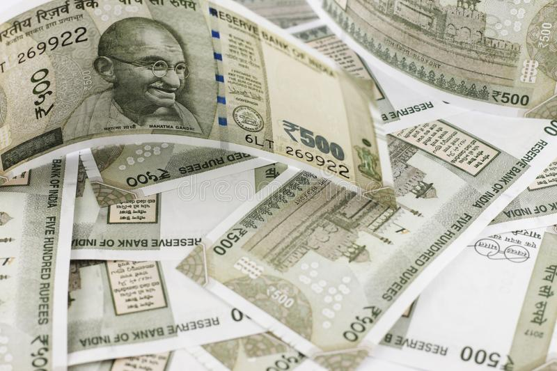 A Bunch of Indian Rupees. A Bunch of Indian currency, five hundred rupees notes spread across a surface stock images