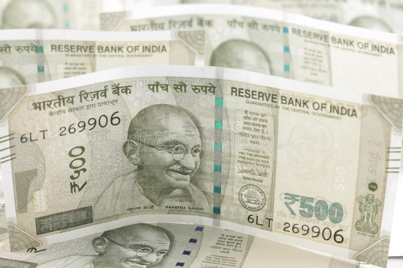 A Bunch of Indian Rupees. A Bunch of Indian currency, five hundred rupees notes spread across a surface stock photography
