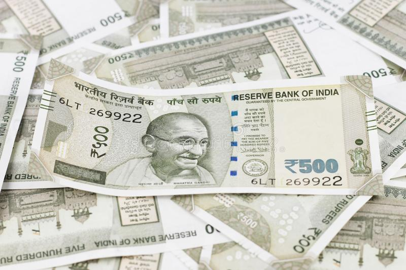 A Bunch of Indian Rupees. A Bunch of Indian currency, five hundred rupees notes spread across a surface stock photos