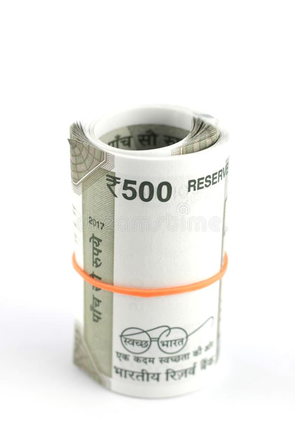 A Bunch of Indian Rupees. A bunch of Indian five hundred rupees currency notes rolled using a rubber band royalty free stock images