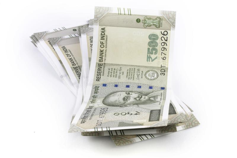 A bunch of Indian Rupees. A bundle of Indian Five Hundred Rupees Notes on a white surface royalty free stock photos