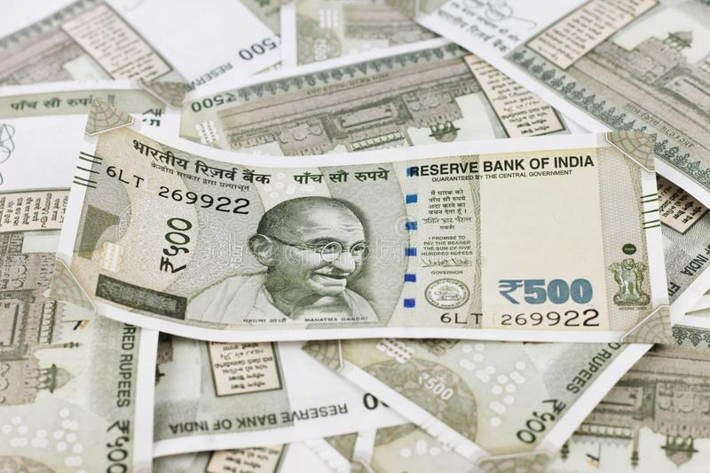 A Bunch of Indian Rupees. A Bunch of Indian currency, five hundred rupees notes spread across a surface royalty free stock images