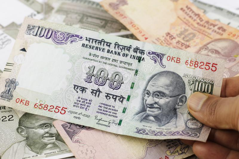A Bunch of Indian Rupees. Indian Money, Indian Currency. A bunch of Indian five hundred rupees currency notes, a fifty rupees note spread across a surface with stock photos