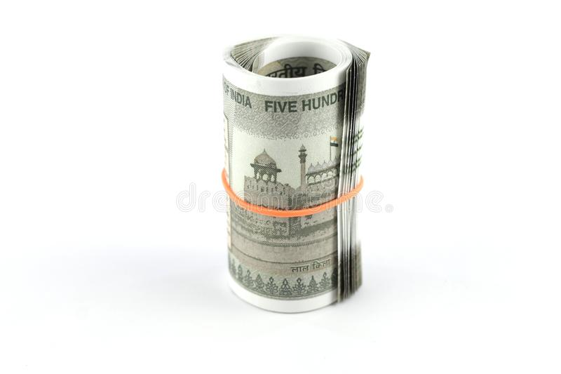 Indian Money, Indian Currency Roll, Currency Rolled with Rubber Band. A Roll of Indian Rupees with Rubber Band. A bunch of Indian five hundred rupees currency stock images