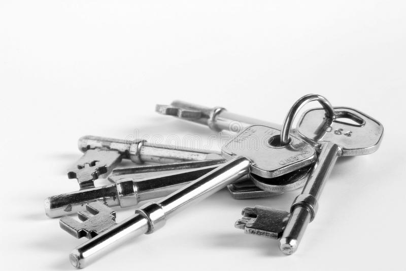 Bunch of keys. Closeup of chrome plated bunch of keys stock photo