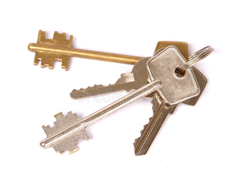 Bunch of keys. A bunch of keys isolated against a white background royalty free stock photo