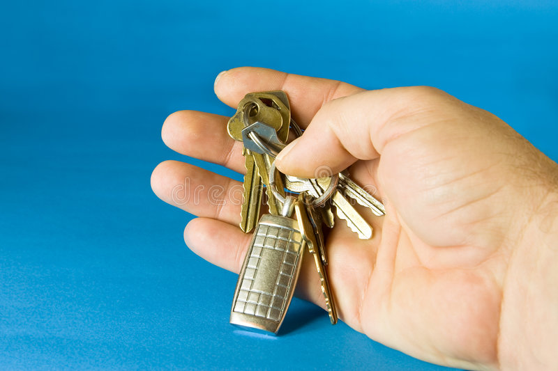 Bunch of keys. With a keyholder on blue background royalty free stock photos