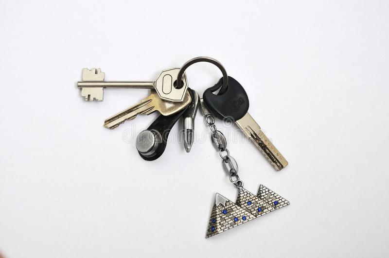 A bunch of keys from the apartment. Bunch of keys with keyring from the apartment isolated on a white background royalty free stock photo