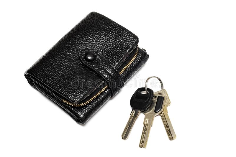 A bunch of keys and a black wallet isolated on white background stock photos