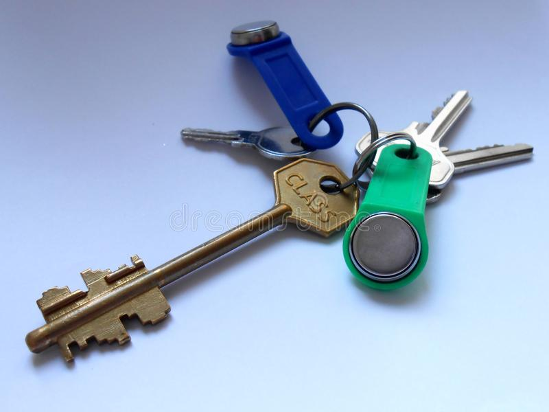 Bunch of keys. Bunch keys, blue, green, white, door, iron, six, metal, open, shut royalty free stock photos