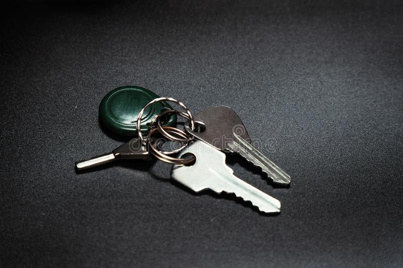 A bunch of keys on a dark background. Selective focus royalty free stock image