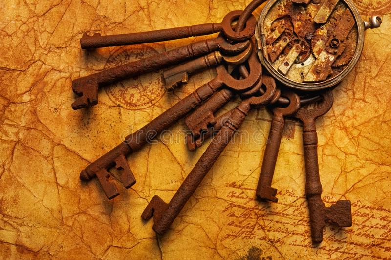 Bunch of keys with a gears. On the old textured paper royalty free stock images