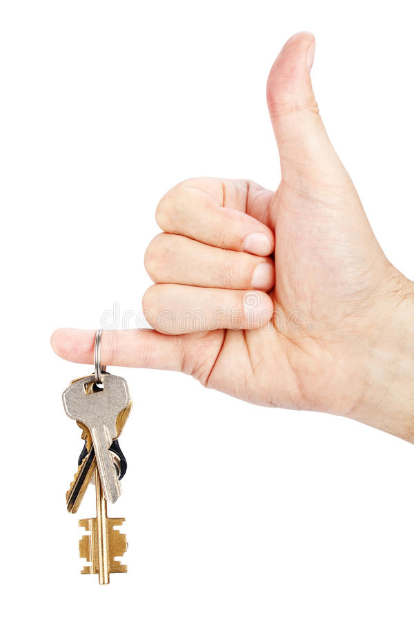 Bunch of keys in hand. On white background royalty free stock image
