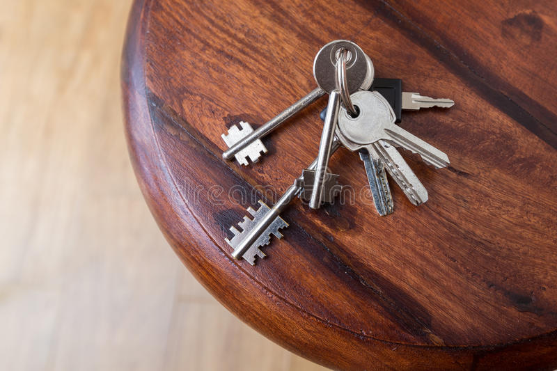 Bunch of keys. Lying on a wood shelf at the entrance royalty free stock photos