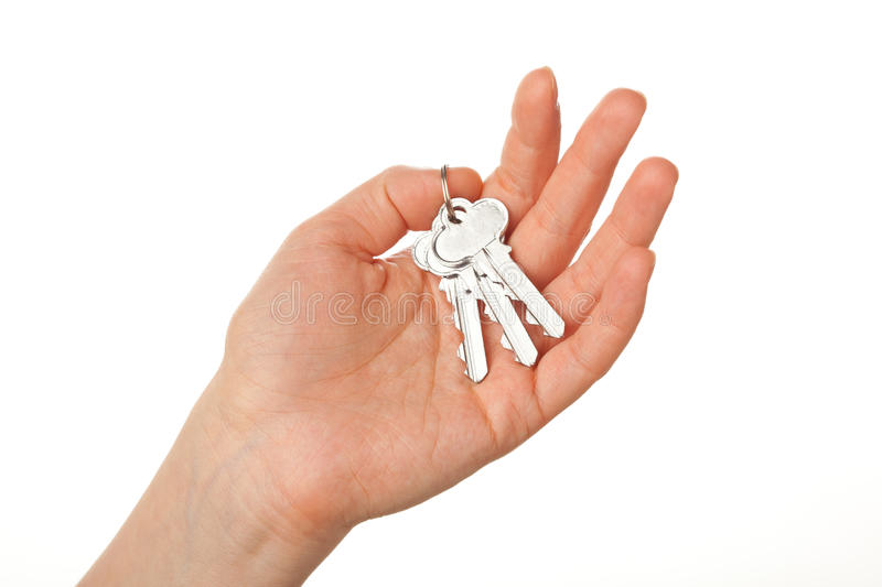 Bunch of keys on the palm. Hand holding bunch of keys, isolated on white stock photography