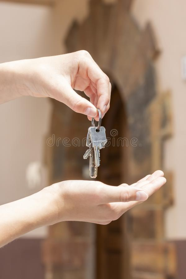 A bunch of keys to the apartment in the hand of a man royalty free stock photography