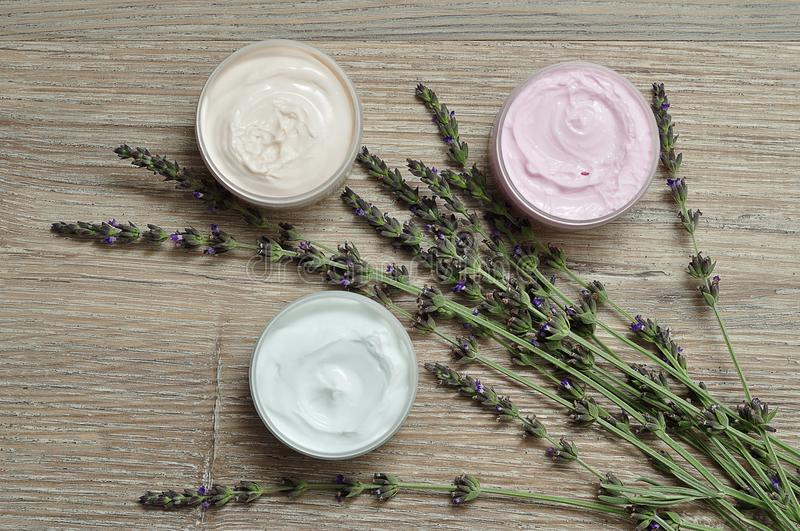 A bunch of lavender displayed with containers of body lotion royalty free stock image