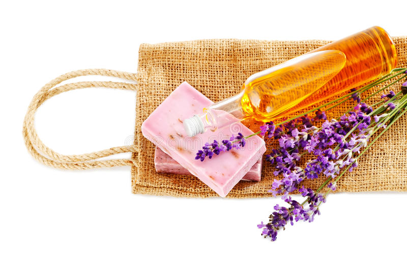 Bunch of lavender flowers, soap and oil isolated on white. Spa tr. Bunch of lavender flowers, soap and oil isolated on white royalty free stock images