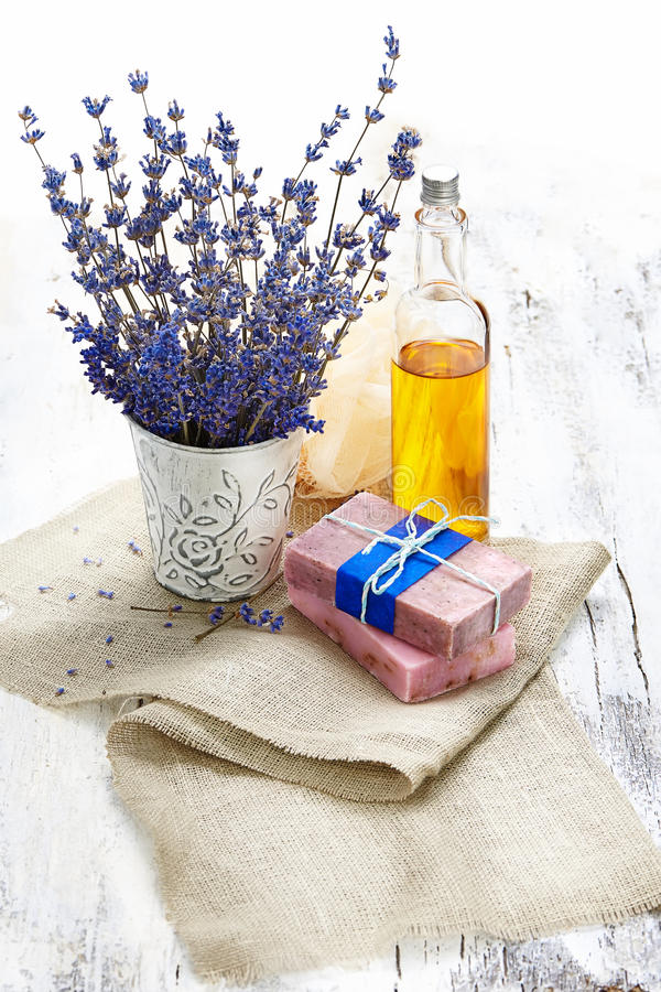 Bunch of lavender flowers,soap on old wooden background.Spa tre royalty free stock photography