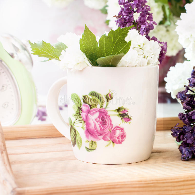 Bunch lilac flowers in a bowl royalty free stock images