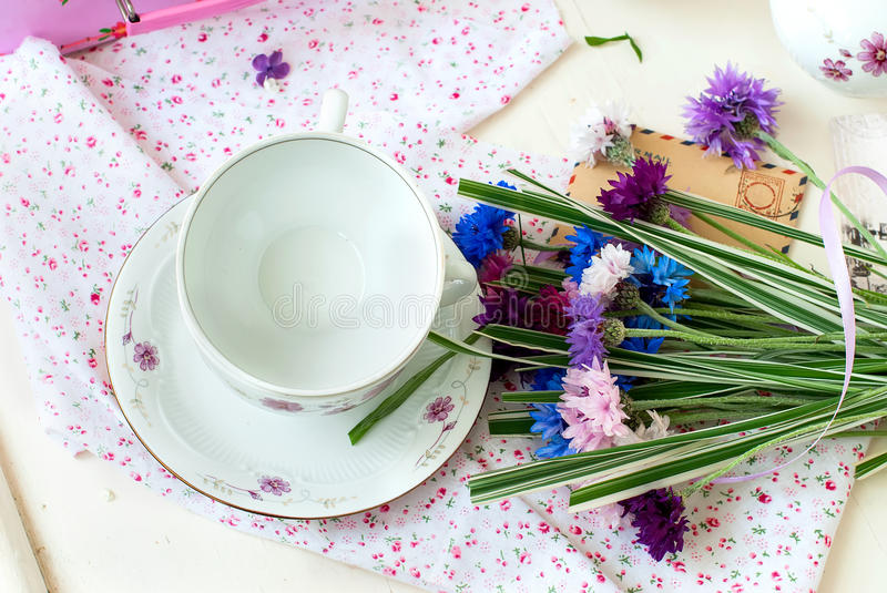 Bunch lilac flowers in a bowl stock photo