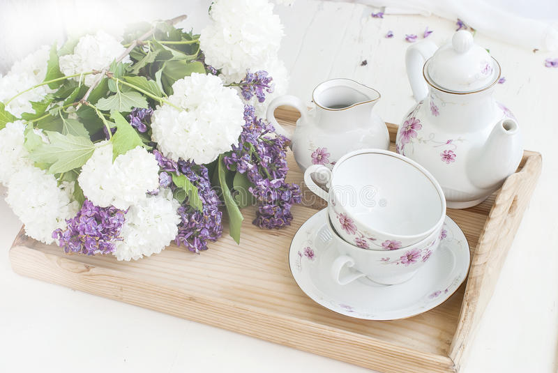 Bunch lilac flowers in a bowl stock image