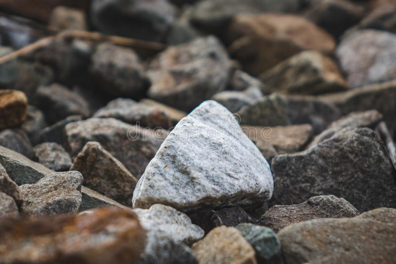 A bunch of little stone mountain of rubble. Crushed, gravel, material, rock, background, mineral, pattern, road, rough, texture, aggregate, ballast, abstract royalty free stock image