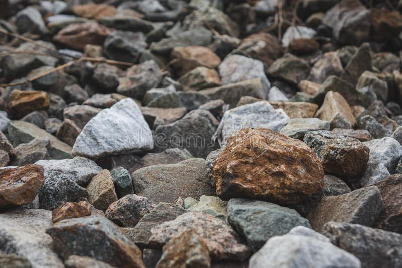 A bunch of little stone mountain of rubble. Crushed, gravel, material, rock, background, mineral, pattern, road, rough, texture, aggregate, ballast, abstract stock photo