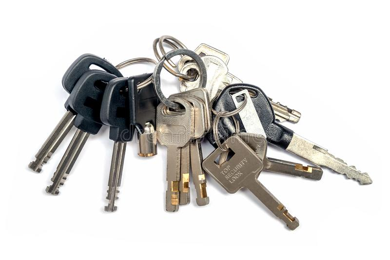 Bunch of Many Keys Lies on an iSolated White Background royalty free stock photo