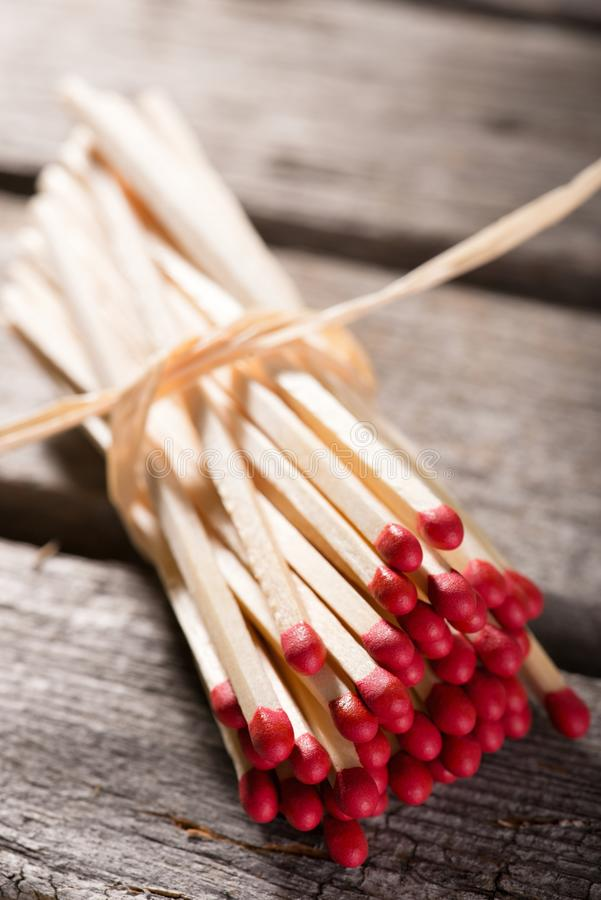 Bunch of matchsticks bonded by piece of straw stock photos