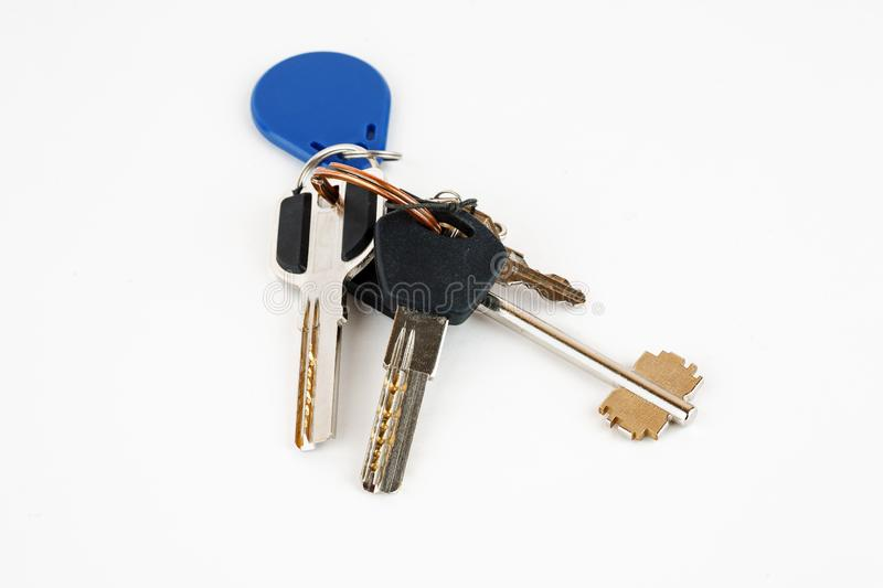Bunch of metal keys isolated on white stock photo