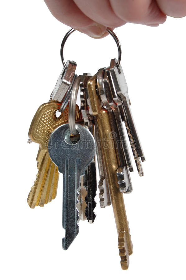 Bunch of metal keys isolated on a white stock image
