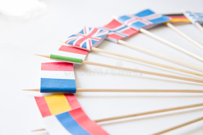 Bunch of miniature paper flags of several countries: Greece,Germany,Sweden,Norway,England,Italy,France,Spain, Russia royalty free stock photos