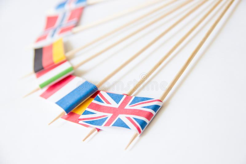 Bunch of miniature paper flags of several countries: UK,Germany,Sweden,Norway,Italy,France,Spain stock images