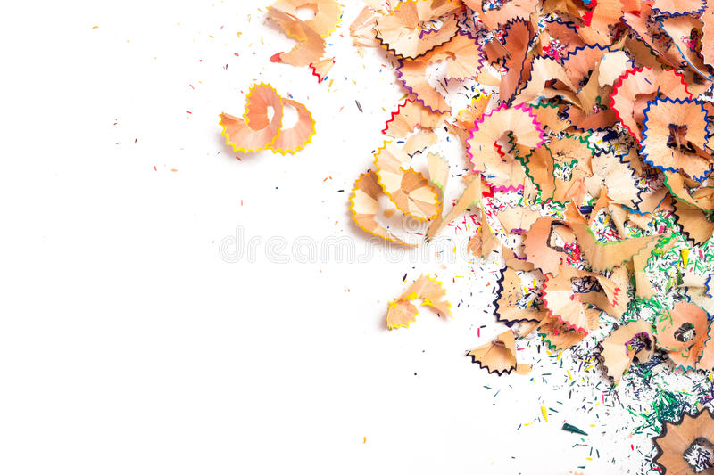 A bunch of multi-colored chips on a pencil sharpener on a white background royalty free stock photo