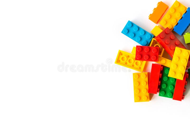 Lego background. Bunch of many Colorful Plastick constructor bricks on white background. Popular toys. Copyspace. A bunch of Multicolor Plastick constructor stock photography