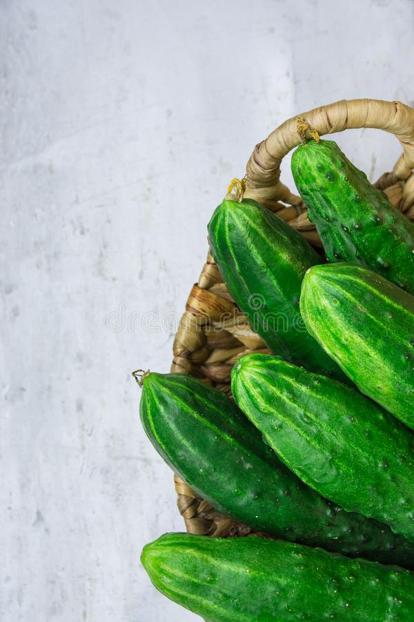 Free Bunch Of Fresh Organic Cucumbers In Wicker Basket On Grey Metal Cement Stone Background. Summer Vitamins Healthy Diet Stock Image - 118473651
