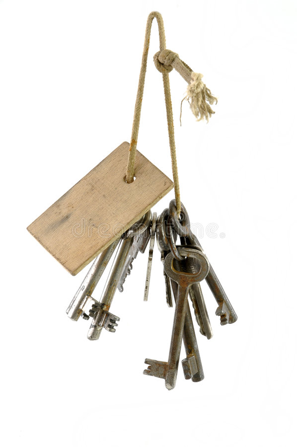 Bunch of old keys hanging. Isolated on white background royalty free stock image