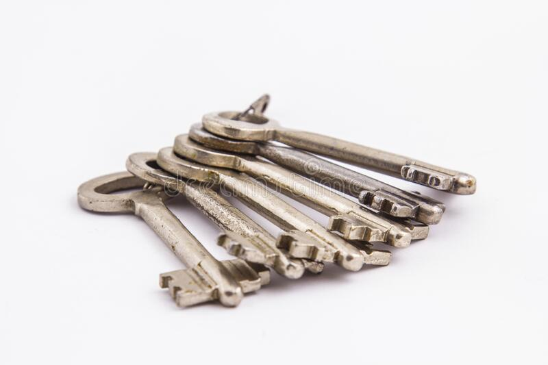 Bunch of old keys on a light background stock image