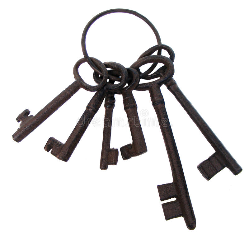 Bunch of old keys. Bunch of rusty old cast iron keys on a ring stock photos
