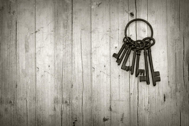 Bunch of old keys. On wooden background black and white royalty free stock photography