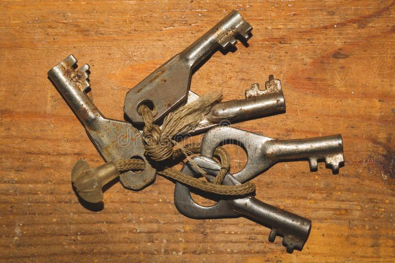 Bunch of old keys  on wooden background stock photo