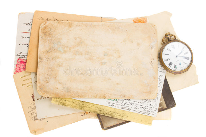 Bunch of old photos and papers with antique clock royalty free stock photos