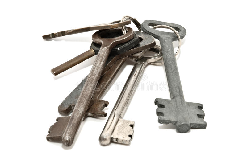 Bunch of old rusty keys, isolated on white stock images