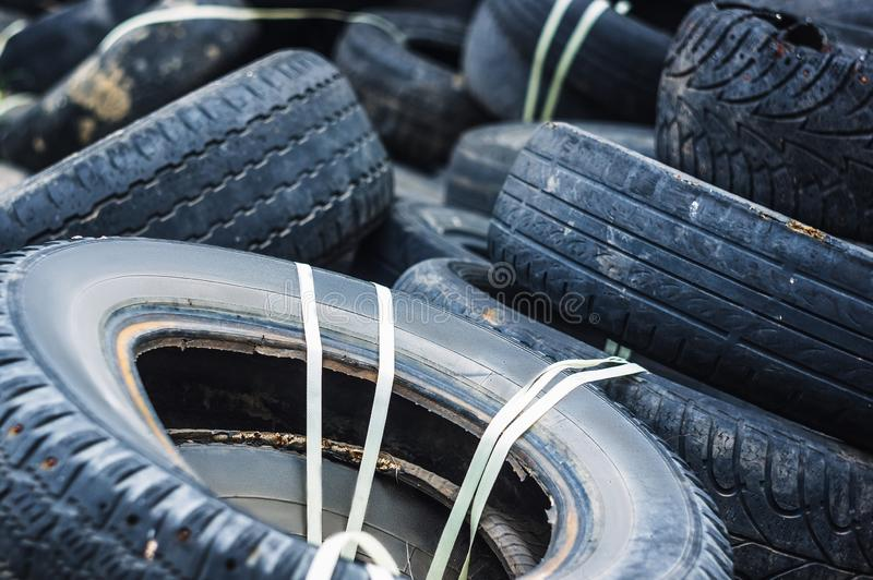 A bunch of old tires from used cars stock images